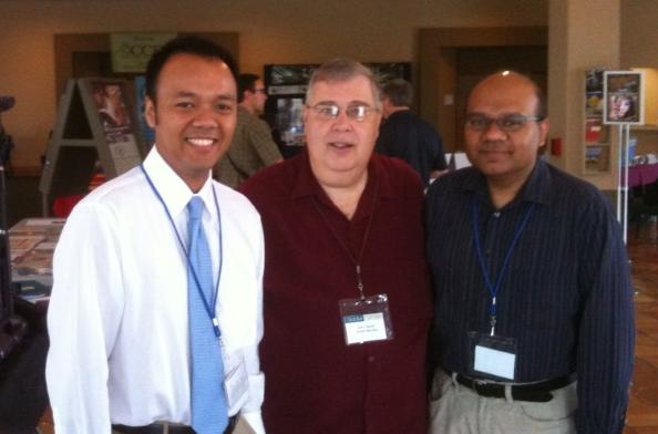 Glen Valuet from CCEA, with Azroy and Fuad from QuickSchools